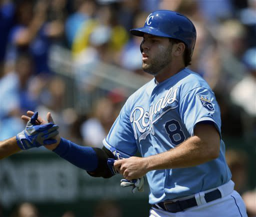 Kansas City Royals' Mike Moustakas (8) scores on a double by Jeff Francouer during the second inning of the first of two baseball games against the Cleveland Indians, Sunday, April 28, 2013, in Kansas City, Mo. (AP Photo/Reed Hoffmann)