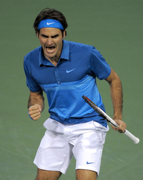 Roger Federer, of Switzerland, celebrates after winning a point over Rafael Nadal, of Spain, during their semifinal match at the BNP Paribas Open tennis tournament, Saturday, March 17, 2012, in Indian Wells, Calif. Federer won 6-3, 6-4. (AP Photo/Mark J. Terrill)
