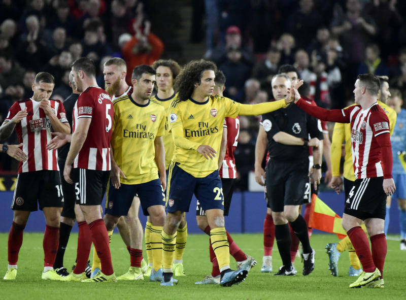 Sheffield United's and Arsenal's players react after the English Premier League soccer match between Sheffield United and Arsenal at Bramall Lane in Sheffield, England, Monday, Oct. 21, 2019. (AP Photo/Rui Vieira)