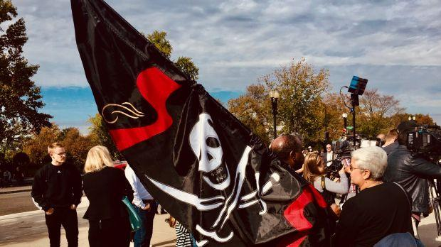 Supporters of Frederick Allen wave pirate flag at SCOTUS.