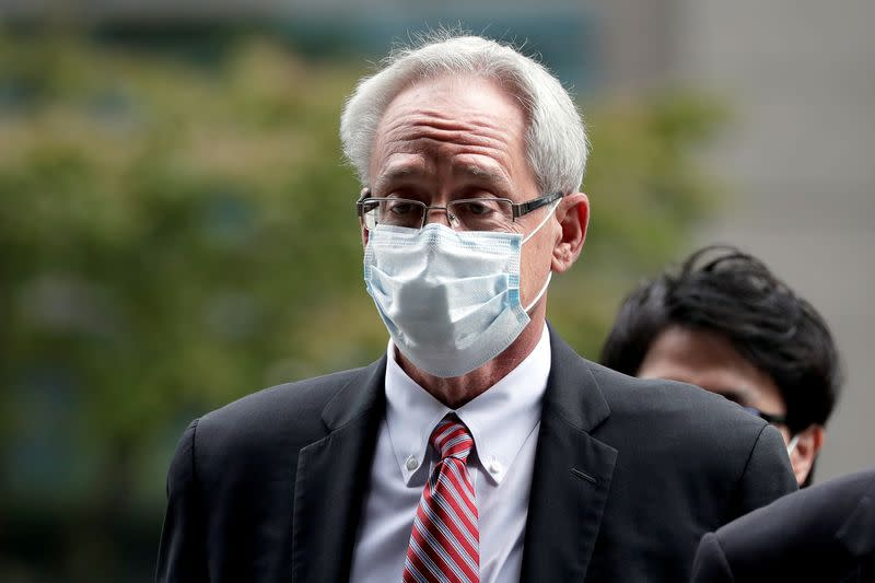 Greg Kelly, former representative director of Nissan Motor Co., arrives for the first trial hearing at the Tokyo District Court in Tokyo