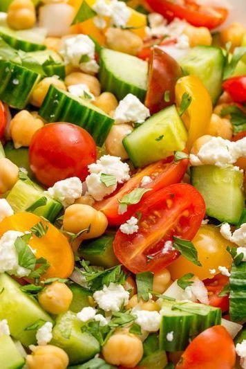"""<p>This salad is super easy to throw together.</p><p>Get the <a href=""""https://www.delish.com/uk/cooking/recipes/a33008226/tomato-cucumber-feta-salad-recipe/"""" rel=""""nofollow noopener"""" target=""""_blank"""" data-ylk=""""slk:Tomato, Cucumber & Feta Salad"""" class=""""link rapid-noclick-resp"""">Tomato, Cucumber & Feta Salad</a> recipe. </p>"""