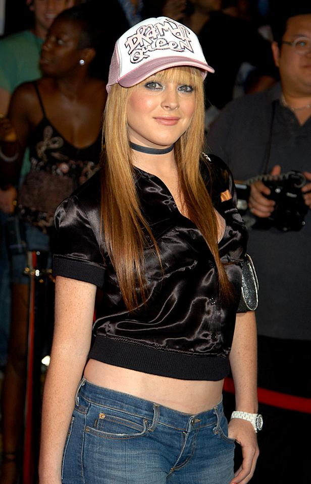 """Sporting a trucker hat promoting her upcoming film, """"Confessions of a Teenage Drama Queen,"""" thick bangs, and a revealing midriff top, Lindsay Lohan popped a pose at the 2003 Stuff magazine Pre-VMA Party in NYC. Ron Galella/<a href=""""http://www.wireimage.com"""" target=""""new"""">WireImage.com</a> - August 27, 2003"""