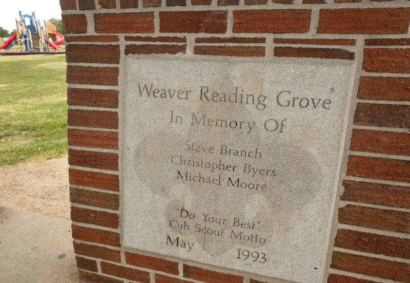 In this photo taken Aug. 13, 2012, an inscription in a Gazebo bearing the names of Steve Branch, Christopher Byers and Michael Moore sits behind Weaver Elementary School in West Memphis, Ark. The three Cub Scouts were killed in 1993. (AP Photo/Danny Johnston)