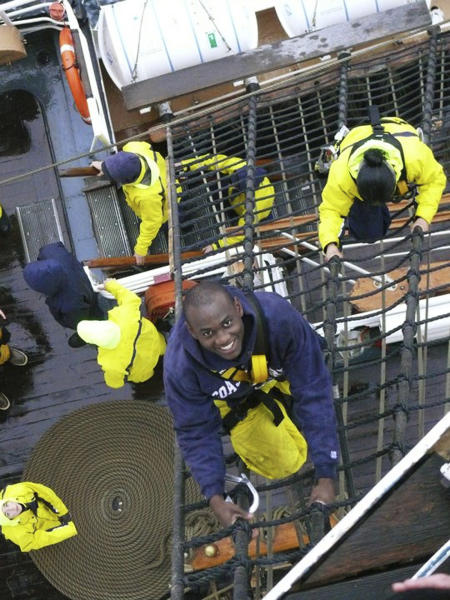 In this May 25, 2011 photo provided by the U.S. Coast Guard, U.S. Coast guard Academy, 1st Class, Cadet Orlando Morel climbs rigging aboard the Coast Guard Cutter Eagle. Morel was 6 years old when he and his mother were rescued by the Coast Guard while leaving Haiti. Morel, now of Rockville, Md., will graduate Wednesday, May 16, 2012, from the Coast Guard Academy in New London, Conn. (AP Photo/U.S. Coast Guard Academy)