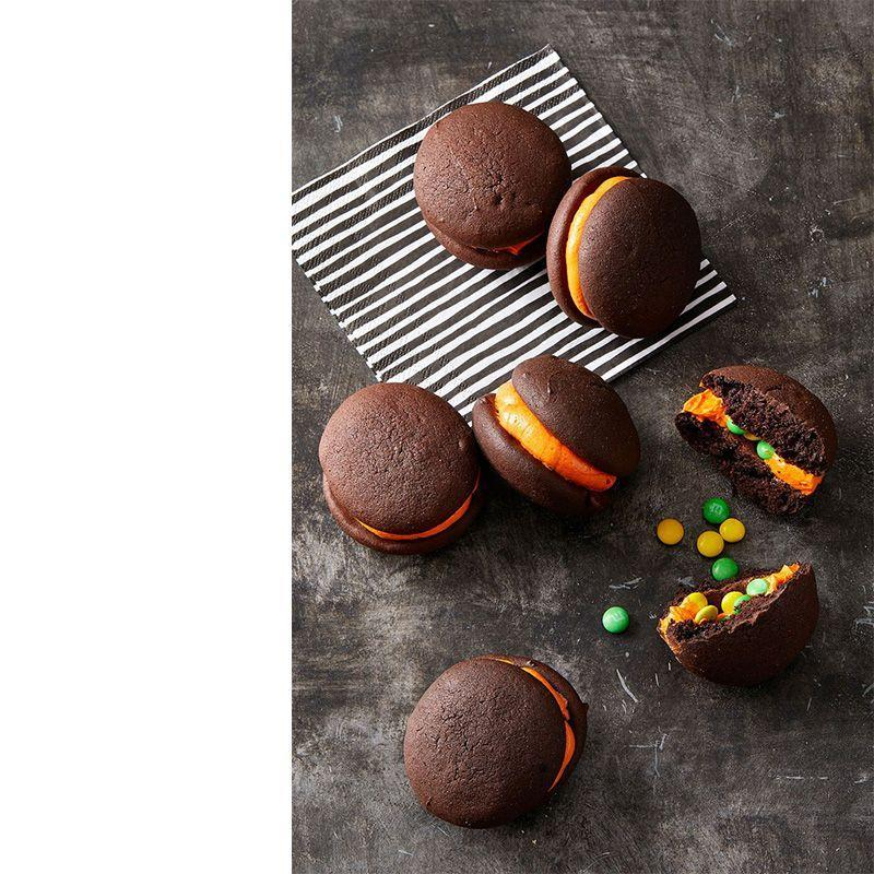 """<p>Hey, who said there couldn't be some sweet treats mixed within the savory and salty apps? Mini whoopie pies, anyone?</p><p><em>Get the recipe at <a href=""""https://www.goodhousekeeping.com/food-recipes/a28542085/stuffed-dark-chocolate-whoopie-pies-recipe/"""" rel=""""nofollow noopener"""" target=""""_blank"""" data-ylk=""""slk:Good Housekeeping"""" class=""""link rapid-noclick-resp"""">Good Housekeeping</a>. </em></p>"""