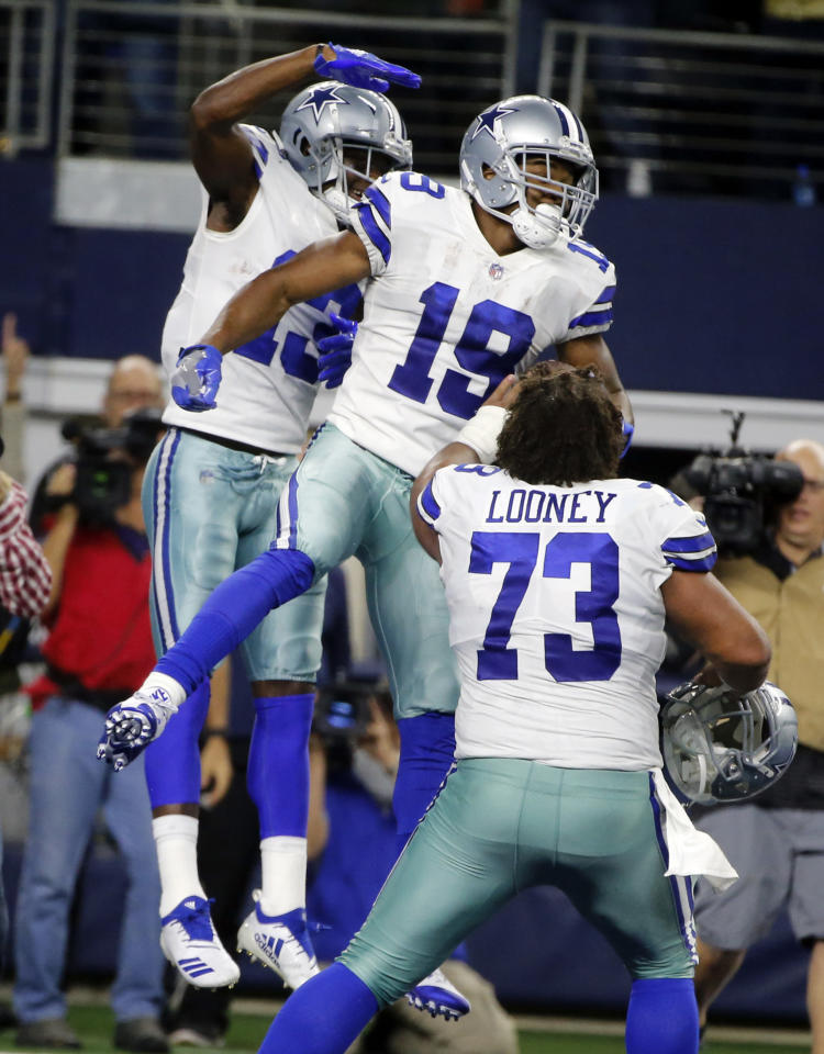 Dallas Cowboys wide receiver Amari Cooper (19) celebrates his touchdown against the Philadelphia Eagles in overtime of an NFL football game, in Arlington, Texas, Sunday, Dec. 9, 2018. (AP Photo/Michael Ainsworth)