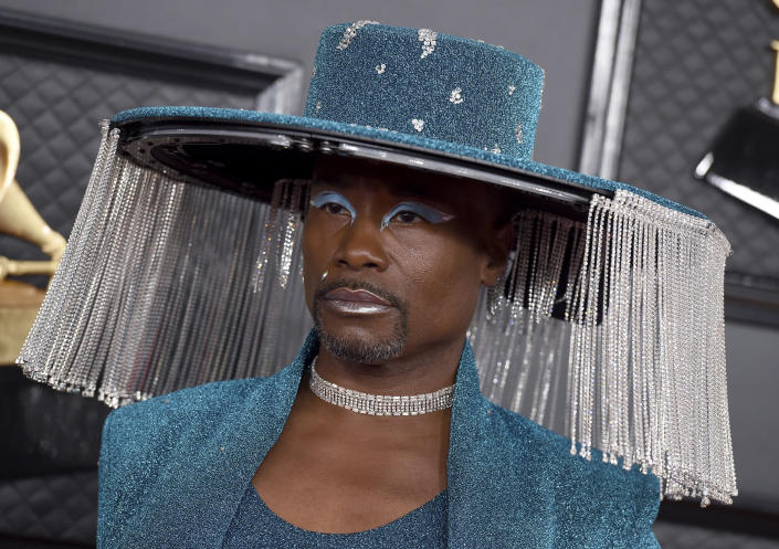 """FILE - Billy Porter arrives at the 62nd annual Grammy Awards in Los Angeles on Jan. 26, 2020. Porter has broken his silence over his HIV diagnosis, saying he no longer wants to live under a cloud of shame. The """"Pose"""" star said in an interview published Wednesday in The Hollywood Reporter that he told nearly no one for 14 years, fearing retaliation and marginalization in his industry. (Photo by Jordan Strauss/Invision/AP, File)"""