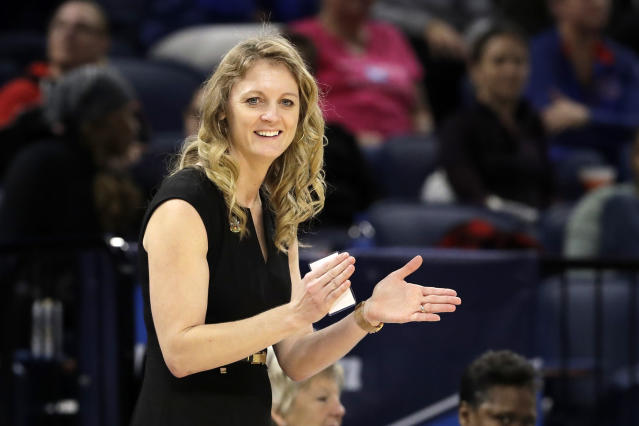 FILE - In this March 30, 2019, file photo, Missouri State head coach Kellie Harper smiles as he directs her team during the second half of a regional semifinal game against the Stanford in the NCAA women's college basketball tournament, in Chicago. New Tennessee coach Kellie Harper played for the Lady Vols when they were regularly winning national champions. She now takes over a Tennessee program thats in a much different place, as it hasnt even reached the Sweet 16 over the last three years. Tennessee is banking on the former Missouri State coach to get this storied program back to national prominence. (AP Photo/Nam Y. Huh, File)