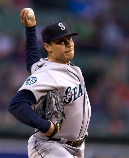 Seattle Mariners' Jason Vargas delivers a pitch against the Boston Red Sox in the first inning of a baseball game at Fenway Park, in Boston, Monday, May 14, 2012. (AP Photo/Steven Senne)