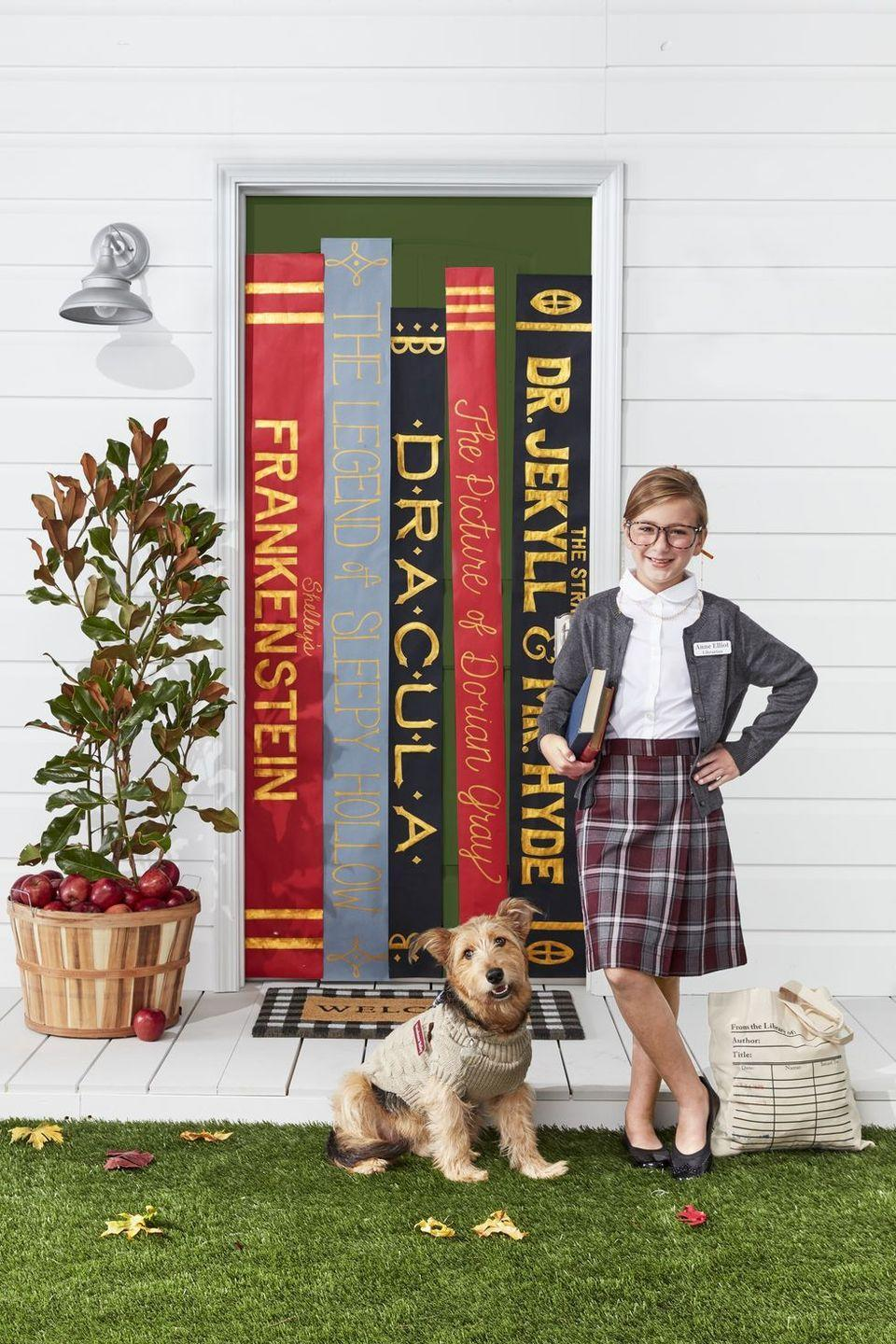 """<p><em>Shhh!</em> We adore the idea of dressing up your child as a smartly dressed librarian. What better way to encourage good reading habits? A library card canvas tote, Peter Pan collar blouse, cardigan sweater, and plaid skirt are just about all you need—oh, and a pair of glasses, of course! </p><p><a class=""""link rapid-noclick-resp"""" href=""""https://www.amazon.com/Library-card-stamps-handbag-Market/dp/B073QTSR1Y?tag=syn-yahoo-20&ascsubtag=%5Bartid%7C10050.g.23785711%5Bsrc%7Cyahoo-us"""" rel=""""nofollow noopener"""" target=""""_blank"""" data-ylk=""""slk:SHOP LIBRARY CARD TOTES"""">SHOP LIBRARY CARD TOTES</a></p>"""