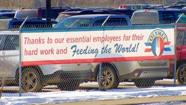 A sign outside the Olymel pork plant in Red Deer, Alta., thanks the company's essential employees. It will reopen on Thursday, after being closed since Feb. 15 due to a COVID-19 outbreak.