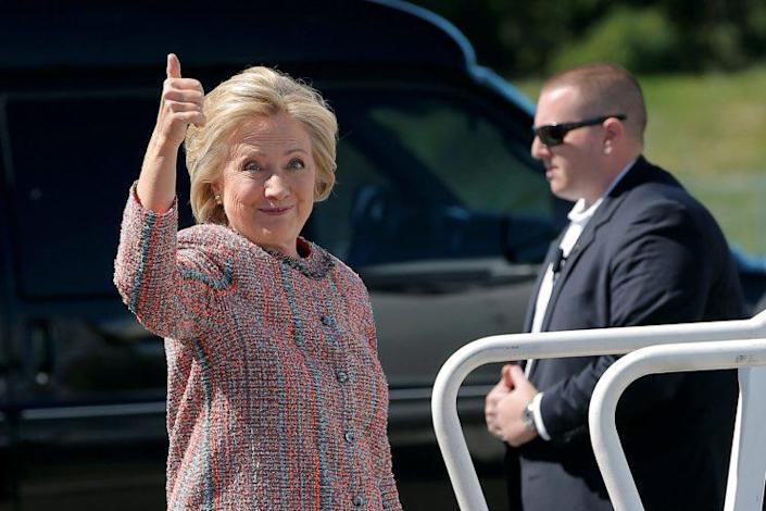 Hillary Clinton gives a thumbs up as she boards her campaign plane in White Plains, N.Y. (Photo: Brian Snyder/Reuters)