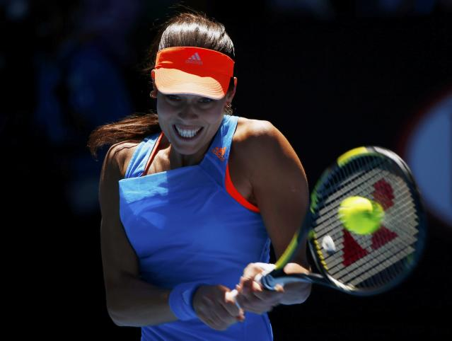 Ana Ivanovic of Serbia hits a return to Eugenie Bouchard of Canada during their women's quarter-final tennis match at the Australian Open 2014 tennis tournament in Melbourne January 21, 2014. REUTERS/Petar Kujundzic (AUSTRALIA - Tags: SPORT TENNIS)