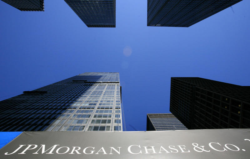 "FILE - In this April 16, 2009 file photo, the headquarters for JPMorgan Chase & Co., left, is shown in New York. Bank of America, Citi, Wells Fargo Bank, JPMorgan Chase and other  banks got together in 1997 and formed a private company called Mortgage Electronic Registry Systems Inc., or MERS. Its motto: ""Process loans, not paperwork.""((AP Photo/Mark Lennihan, file)"