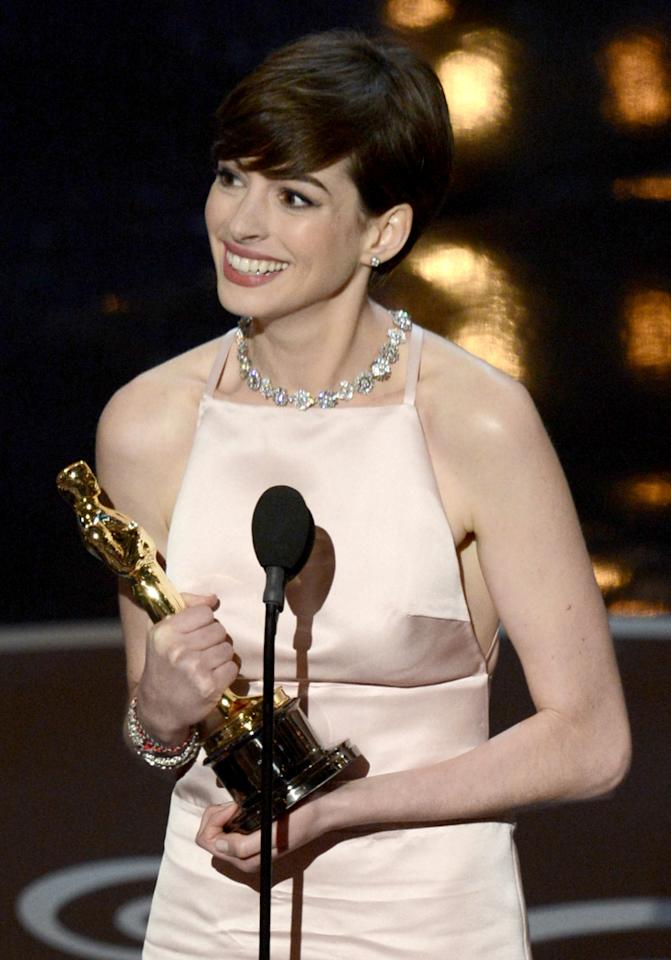 "HOLLYWOOD, CA - FEBRUARY 24:  Actress Anne Hathaway accepts the Best Supporting Actress award for ""Les Miserables"" onstage during the Oscars held at the Dolby Theatre on February 24, 2013 in Hollywood, California.  (Photo by Kevin Winter/Getty Images)"