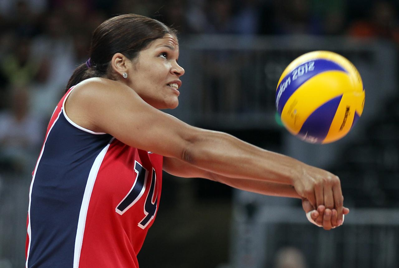 LONDON, ENGLAND - JULY 28:  Prisilla Altagracia Rivera Brens #14 of Dominican Republic returns a shot to team Italy during Women's Volleyball on Day 1 of the London 2012 Olympic Games at Earls Court on July 28, 2012 in London, England.  (Photo by Elsa/Getty Images)