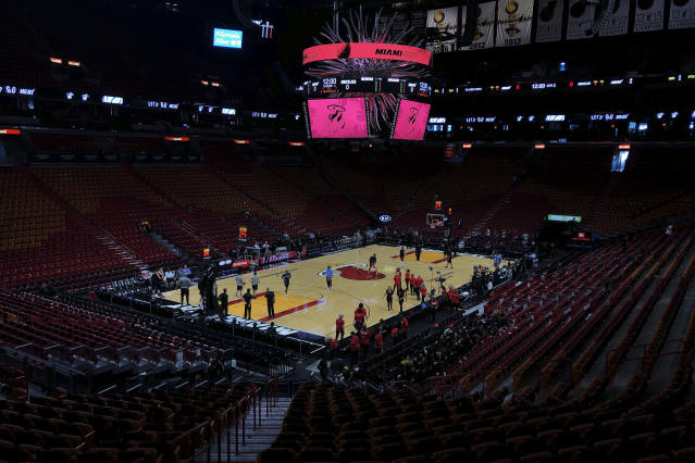 FILE - In this Oct. 23, 2019, file photo, the Miami Heat and the Memphis Grizzlies practice before an NBA basketball game in Miami, Fla. If so inclined, NBA teams like Miami, Orlando and Utah could all be back in the gym for voluntary workouts in small groups starting Friday when the league ban on such things expires. None of them will be reopening that day. There's a clear desire for basketball to resume but, perhaps mindful of how rushing back too quickly hurt other leagues around the world, the NBA seems to be taking very cautious baby steps back to the court. (AP Photo/Brynn Anderson, File)