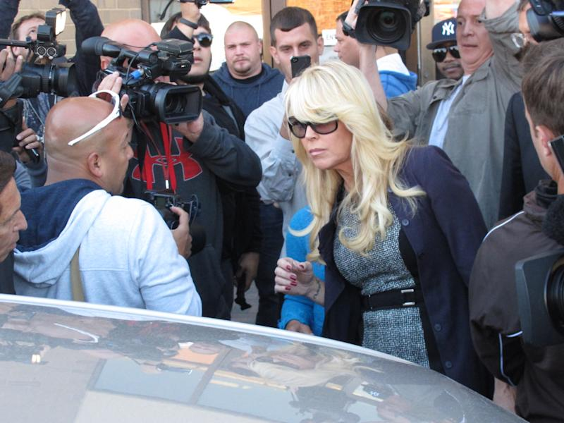 Dina Lohan leaves court in Hempstead, N.Y. on Tuesday, Sept. 24, 2013 after pleading not guilty to drunken driving charges. The mother of actress Lindsay Lohan was arrested on Sept. 12, accused of driving with more than double the legal limit of alcohol in her system. She has pleaded not guilty. (AP Photo/Frank Eltman)