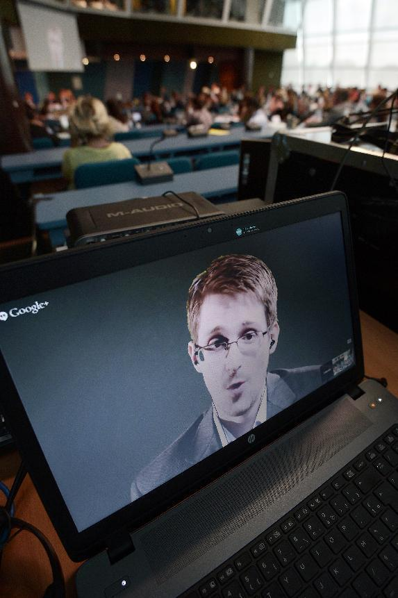 US National Security Agency whistleblower Edward Snowden speaks to European officials via videoconference at the Council of Europe in Strasbourg, eastern France, on June 24, 2014 (AFP Photo/Frederick Florin)