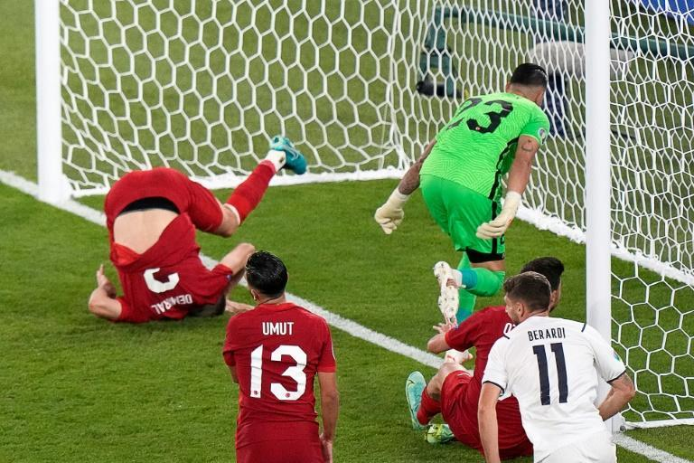 Turkey's defender Merih Demiral (L) turned into his own net against Italy