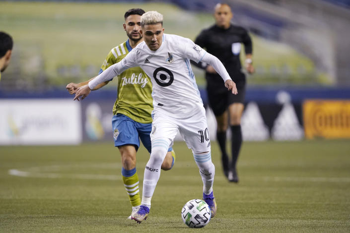 FILE - Minnesota United midfielder Emanuel Reynoso dribbles against the Seattle Sounders during the second half of an MLS playoff Western Conference final soccer match in Seattle, in this Monday, Dec. 7, 2020, file photo. Reynoso is being talked about as a potential breakout star for the upcoming Major League Soccer season.(AP Photo/Ted S. Warren, File)