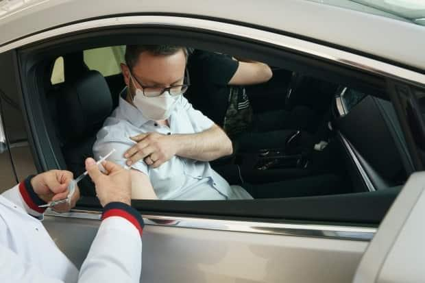 About 15 people were vaccinated in a demonstration Tuesday morning at the drive-thru vaccination clinic at Montreal's Trudeau Internation Airport, which will open May 17. (Ivanoh Demers/Radio-Canada - image credit)