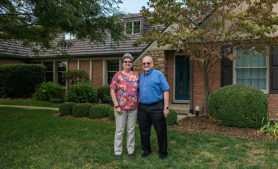 Todd Miller, 57, and Lisa Miller, 58, in front of their home in Sidney, Ohio.
