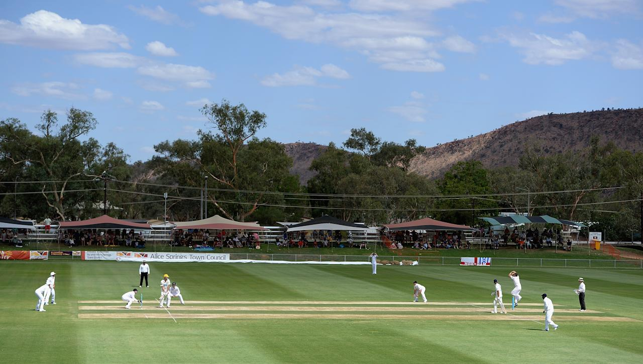 ALICE SPRINGS, AUSTRALIA - NOVEMBER 30:  Graeme Swann of England bowls to Ashton Turner of Chairmans XI during day two of the tour match between the Chairman's XI and England at Traeger Park on November 30, 2013 in Alice Springs, Australia.  (Photo by Gareth Copley/Getty Images)