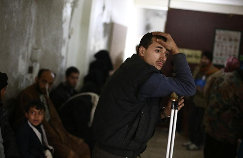 A Syrian man leans on a crutch at a makeshift hospital in the rebel held area of Douma, following reported air strikes by forces loyal to President Bashar al-Assad on February 3, 2015 (AFP Photo/Abed Doumani)