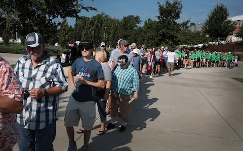 People wait for the gates to open at Saluki Stadium on the campus of Southern Illinois University to watch the solar eclipse - Credit: Getty