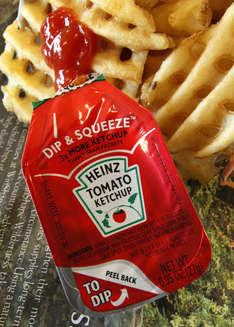 In this May 23, 2011 photo an individual serving packet of Heinz Ketchup is displayed at a restaurant in Robinson Township, Pa. H.J. Heinz Co.'s fiscal fourth-quarter profit rose 16 percent as the world's largest ketchup maker expanded its global reach.  (AP Photo/Gene J. Puskar)