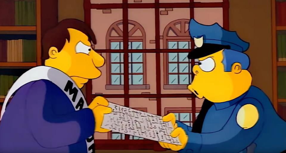 Mayor Quimby and Chief Wiggum fight over the charter (Photo: Fox)