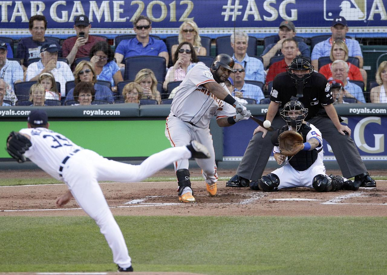 National League's Pablo Sandoval, of the San Francisco Giants, hits a three-run triple on a pitch by American League's Justin Verlander, of the Detroit Tigers, in the first inning the MLB All-Star baseball game Tuesday, July 10, 2012, in Kansas City, Mo. (AP Photo/Charlie Neibergall)