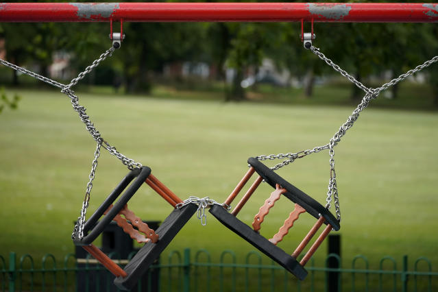 Children's play swings remained locked and chained, due to the pandemic, in Spinney Hill Park, Leicester. (Getty)