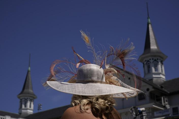 A woman stands in the paddock before the 147th running of the Kentucky Derby at Churchill Downs on Saturday.