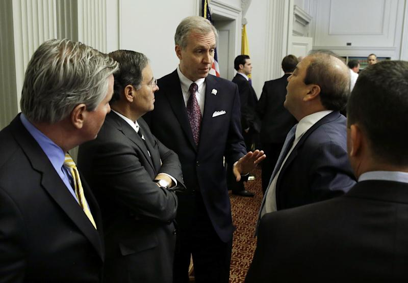 New Jersey Assemblyman John S. Wisniewski, center, D-Sayreville, N.J., co-chair of a joint bipartisan committee of members of the New Jersey Senate and Assembly, talks with Republican Assembly Leader, Jon M. Bramnick, second left, R-Westfield, N.J., and Sen. Kevin J. O'Toole, R-Wayne, N.J., second from right, and others before a meeting at the Statehouse in Trenton, N.J., Monday, Feb. 10, 2014. More subpoenas are expected to be issued by a New Jersey legislative committee investigating a plot to create gridlock by blocking lanes near the George Washington Bridge. (AP Photo/Mel Evans)