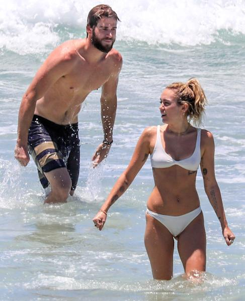 Miley Cyrus Wears White Bikini to Beach With Liam Hemsworth