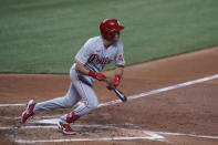 Philadelphia Phillies' Adam Haseley gets a base hit, scoring Phil Gosselin, during the fourth inning of a baseball game against the Miami Marlins, Friday, Sept. 11, 2020, in Miami. (AP Photo/Wilfredo Lee)