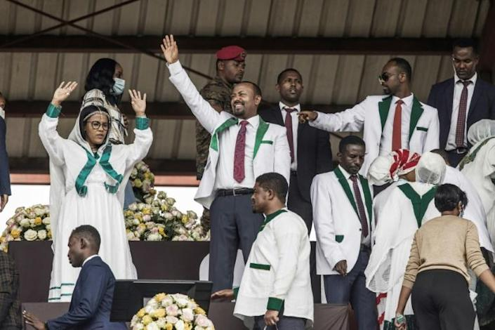 Ethiopian Prime Minister Abiy Ahmed, centre, waves to supporters at the rally in Jimma