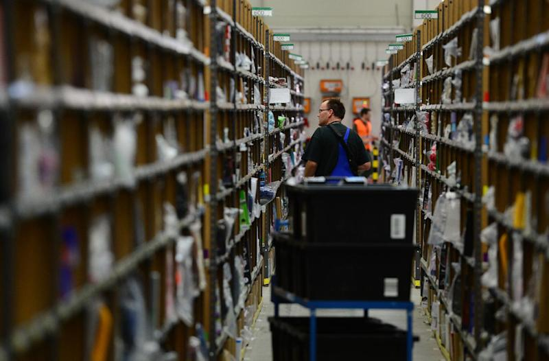 Storage shelves at a logistics center for US online retail giant Amazon (AFP Photo/John Macdougall)