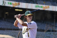Oakland Athletics draft pick Max Muncy poses for photos before a baseball game between the Athletics and the Los Angeles Angels in Oakland, Calif., Monday, July 19, 2021. (AP Photo/Jeff Chiu)