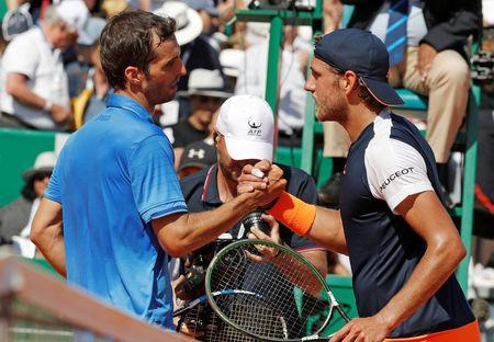 Tennis - Monte Carlo Masters - Monaco, 22/04/2017. Albert Ramos-Vinolas of Spain shakes hand with Lucas Pouille of France after their match. REUTERS/Eric Gaillard