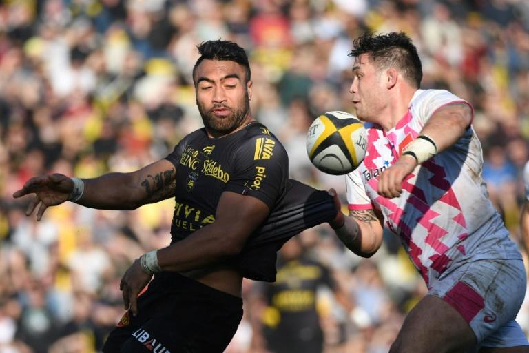 La Rochelle's Victor Vito (L) is tackled by Stade Francais' Laurent Sempere during their French Top 14 rugby union match, at the Marcel Deflandre stadium in La Rochelle, on February 18, 2017