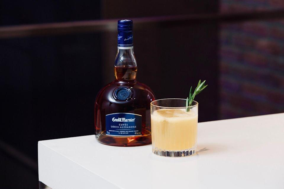 <p><strong>Ingredients</strong></p><p>2 oz Grand Marnier Cuvée Louis-Alexandre<br>.75 oz grapefruit juice<br>.5 bar spoon honey<br>.5 oz lemon juice</p><p><strong>Instructions</strong></p><p>Stir all ingredients in a rocks glass. Add ice. Garnish with rosemary sprigs and sprayed with orange flower water.</p>
