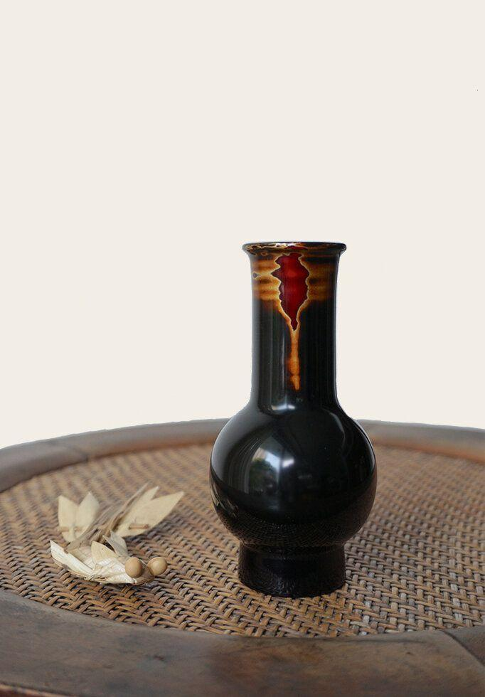 """<p>sage-collective.com</p><p><strong>$170.00</strong></p><p><a href=""""https://www.sage-collective.com/all-collections/p/red-lacquer-and-wood-body-vase"""" rel=""""nofollow noopener"""" target=""""_blank"""" data-ylk=""""slk:SHOP NOW"""" class=""""link rapid-noclick-resp"""">SHOP NOW</a></p><p>Sage Collective cultivates connections between Chinese culture and the rest of the world through artisanal home goods, tea, tools, and more. You'll find kitchen necessities, unique tabletop decor, candles, and vintage pieces.</p>"""