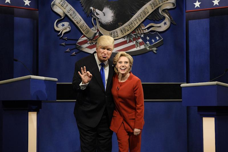 """In this photo provided by NBC, Alec Baldwin, left, as Republican presidential candidate, Donald Trump, and Kate McKinnon, as Democratic presidential candidate, Hillary Clinton, perform during the """"Debate Cold Open"""" sketch on the 42nd season of """"Saturday Night Live,"""" in New York, Saturday, Oct. 1, 2016. (Will Heath/NBC via AP) MANDATORY CREDIT"""