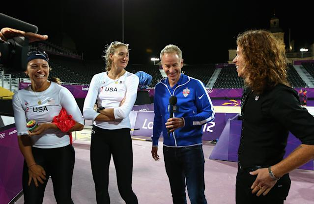 Kerri Walsh Jennings and Misty May-Treanor of the United States are interviewd by John McEnroe and Shaun White after the Women's Beach Volleyball Preliminary match between United States and Czech Republic on Day 3 of the London 2012 Olympic Games at Horse Guards Parade on July 30, 2012 in London, England. (Photo by Ryan Pierse/Getty Images)