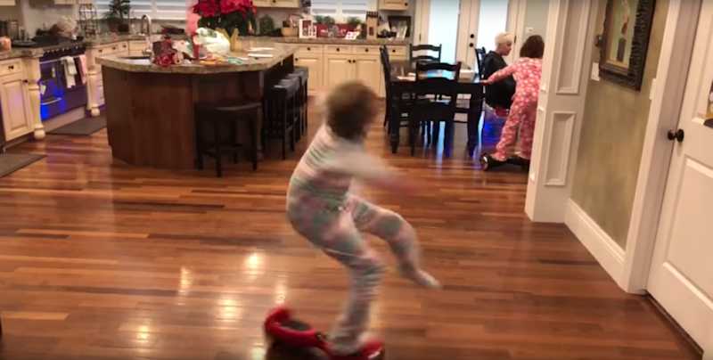 She spun completely off the hoverboard. Photo: YouTube/Kids Getting Hurt