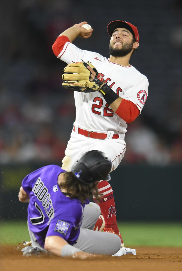Los Angeles Angels third baseman David Fletcher throws from second base after forcing out Colorado Rockies' Brendan Rodgers in the seventh inning a baseball game Wednesday, July 28, 2021, in Anaheim, Calif. Elias Diaz was safe at first on a throwing error by Fletcher. (AP Photo/John McCoy)